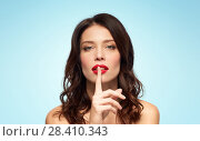 Купить «woman with red lipstick holding finger on mouth», фото № 28410343, снято 5 января 2018 г. (c) Syda Productions / Фотобанк Лори
