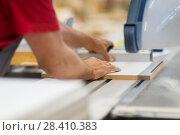 Купить «carpenter with panel saw and fibreboard at factory», фото № 28410383, снято 10 ноября 2017 г. (c) Syda Productions / Фотобанк Лори