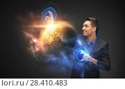 businessman with virtual planet and space hologram. Стоковое фото, фотограф Syda Productions / Фотобанк Лори
