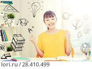 Купить «happy asian young woman student learning at home», фото № 28410499, снято 9 марта 2016 г. (c) Syda Productions / Фотобанк Лори