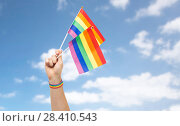 Купить «hand with gay pride rainbow flags and wristband», фото № 28410543, снято 2 ноября 2017 г. (c) Syda Productions / Фотобанк Лори