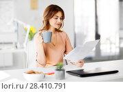 Купить «businesswoman with papers drinks coffee at office», фото № 28410791, снято 17 марта 2018 г. (c) Syda Productions / Фотобанк Лори
