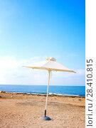 Купить «Alone sunumbrella at mediterranean beach in the morning, Paphos, Cyprus», фото № 28410815, снято 16 июля 2017 г. (c) Papoyan Irina / Фотобанк Лори