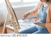Купить «artist with palette knife painting at art studio», фото № 28410931, снято 1 июня 2017 г. (c) Syda Productions / Фотобанк Лори
