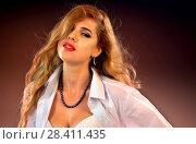 Купить «Woman with duck lips. Pin up girl wearing unbuttoned blouse and bra.», фото № 28411435, снято 25 мая 2018 г. (c) Gennadiy Poznyakov / Фотобанк Лори