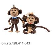 Handmade pair of monkeys on white background (2015 год). Редакционное фото, фотограф Сергей Бочаров / Фотобанк Лори