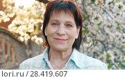 Купить «Mature woman at spring time», видеоролик № 28419607, снято 2 мая 2018 г. (c) Илья Шаматура / Фотобанк Лори