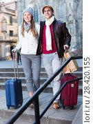 Купить «male and female in the historic center with baggage», фото № 28420155, снято 18 ноября 2017 г. (c) Яков Филимонов / Фотобанк Лори