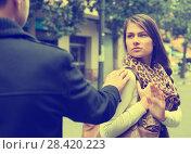 Купить «Annoying Caucasian guy chasing irritated woman», фото № 28420223, снято 18 октября 2018 г. (c) Яков Филимонов / Фотобанк Лори
