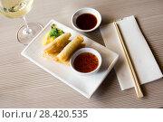 Купить «served harumaki dish», фото № 28420535, снято 15 ноября 2018 г. (c) Яков Филимонов / Фотобанк Лори