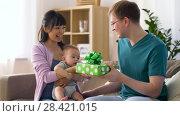 Купить «mother with baby giving birthday present to father», видеоролик № 28421015, снято 12 мая 2018 г. (c) Syda Productions / Фотобанк Лори