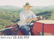 Купить «Man on tractor in vineyard», фото № 28426959, снято 22 января 2018 г. (c) Яков Филимонов / Фотобанк Лори
