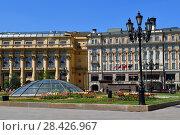 Купить «Moscow, Russia - May 12. 2018. Manezhnaya square with Zholtov house and hotel National», фото № 28426967, снято 12 мая 2018 г. (c) Володина Ольга / Фотобанк Лори