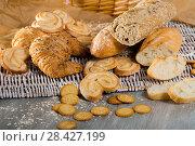 Купить «Baked goods on wicker mat», фото № 28427199, снято 30 января 2018 г. (c) Яков Филимонов / Фотобанк Лори