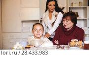 Купить «Portrait of upset little girl scolded by mother and grandma at home», видеоролик № 28433983, снято 27 ноября 2017 г. (c) Яков Филимонов / Фотобанк Лори