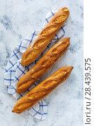 Купить «Freshly baked artisanal baguettes», фото № 28439575, снято 18 мая 2018 г. (c) Марина Сапрунова / Фотобанк Лори