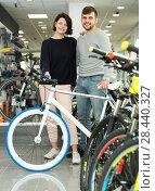 Купить «girl and male standing with bicycle», фото № 28440327, снято 8 января 2018 г. (c) Яков Филимонов / Фотобанк Лори