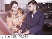 Young woman is disappointed of tire replacement of her car in wi. Стоковое фото, фотограф Яков Филимонов / Фотобанк Лори