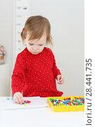 Купить «Cute 2 years girl with mosaic at home», фото № 28441735, снято 6 февраля 2018 г. (c) ivolodina / Фотобанк Лори