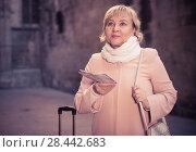 Купить «Mature woman with map and baggage», фото № 28442683, снято 27 ноября 2017 г. (c) Яков Филимонов / Фотобанк Лори