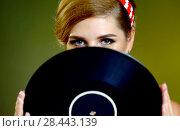 Купить «Retro woman with music vinyl record. Pin-up retro female style», фото № 28443139, снято 21 сентября 2018 г. (c) Gennadiy Poznyakov / Фотобанк Лори