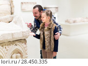 Купить «Father and small girl looking to old bas-reliefs», фото № 28450335, снято 18 июля 2018 г. (c) Яков Филимонов / Фотобанк Лори