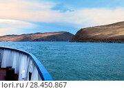 Купить «Lake Baikal in the spring afternoon. Journey on a passenger ferry to the island of Olkhon through the Olkhonsky Gate (Proliv Olhonskie Vorota)», фото № 28450867, снято 18 мая 2018 г. (c) Виктория Катьянова / Фотобанк Лори