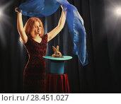 Купить «girl shows focus with a rabbit in a hat», фото № 28451027, снято 19 мая 2018 г. (c) Майя Крученкова / Фотобанк Лори