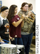 Купить «High School Girls Playing Instruments in Band Ensemble, Wellsville, New York, USA.», фото № 28452043, снято 1 декабря 2017 г. (c) age Fotostock / Фотобанк Лори