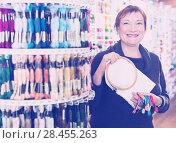 Купить «Woman buying embroidery accessories», фото № 28455263, снято 10 мая 2017 г. (c) Яков Филимонов / Фотобанк Лори