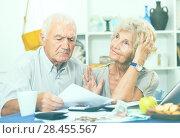 Купить «Frustrated senior couple faced financials troubles», фото № 28455567, снято 28 августа 2017 г. (c) Яков Филимонов / Фотобанк Лори
