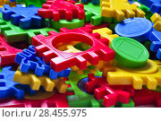 Купить «Детский разноцветный пластмассовый пазл конструктор. Фон», фото № 28455975, снято 25 января 2018 г. (c) Алёшина Оксана / Фотобанк Лори