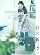 Купить «Young woman with vacuum cleaner», фото № 28460127, снято 9 апреля 2017 г. (c) Яков Филимонов / Фотобанк Лори