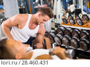 Купить «Young man making biceps curls in gym», фото № 28460431, снято 4 октября 2016 г. (c) Яков Филимонов / Фотобанк Лори