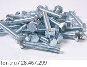 Metal bolts on white background. Стоковое фото, фотограф Юрий Бизгаймер / Фотобанк Лори