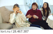 Купить «Little girl sitting at home crying while mom and granny scolding her», видеоролик № 28467387, снято 27 ноября 2017 г. (c) Яков Филимонов / Фотобанк Лори