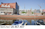 Купить «Aerial view of Gdansk cityscape with building crane working on construction site on Granary Island», видеоролик № 28467407, снято 12 мая 2018 г. (c) Яков Филимонов / Фотобанк Лори