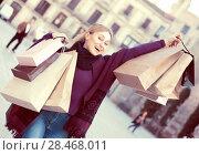 Купить «Young woman holding shopping paper bags», фото № 28468011, снято 19 сентября 2019 г. (c) Яков Филимонов / Фотобанк Лори