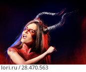 Купить «Black magic ritual mad satan woman in hell on Halloween.», фото № 28470563, снято 23 марта 2017 г. (c) Gennadiy Poznyakov / Фотобанк Лори