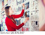 Купить «Female buying hair dye», фото № 28470847, снято 17 августа 2018 г. (c) Яков Филимонов / Фотобанк Лори
