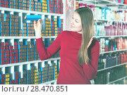 Купить «Female buying hair dye», фото № 28470851, снято 22 марта 2018 г. (c) Яков Филимонов / Фотобанк Лори