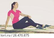 Купить «Woman relaxing after workout outdoors», фото № 28470875, снято 8 мая 2017 г. (c) Яков Филимонов / Фотобанк Лори
