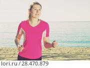 Sporty woman running on ocean beach. Стоковое фото, фотограф Яков Филимонов / Фотобанк Лори