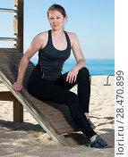 Купить «Woman relaxing after workout outdoors», фото № 28470899, снято 8 мая 2017 г. (c) Яков Филимонов / Фотобанк Лори