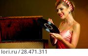 Купить «Retro woman with music vinyl record. Pin-up retro female style», фото № 28471311, снято 18 июля 2018 г. (c) Gennadiy Poznyakov / Фотобанк Лори