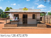 Купить «Front exterior of local grocery store located in Mukuni Village with blues skies up above, Zambia.», фото № 28472879, снято 10 января 2018 г. (c) age Fotostock / Фотобанк Лори