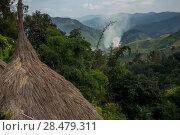 Купить «Thatched roofed houses in village in mountainous area, Chiang Rai, Thailand», фото № 28479311, снято 11 декабря 2016 г. (c) Ingram Publishing / Фотобанк Лори