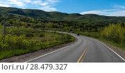Купить «Empty road passing through rural landscape, Cabot Trail, Cape Breton Island, Nova Scotia, Canada», фото № 28479327, снято 12 июня 2016 г. (c) Ingram Publishing / Фотобанк Лори