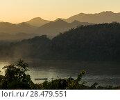 Купить «Elevated view of River Mekong, Mount Phousi, Luang Prabang, Laos», фото № 28479551, снято 24 апреля 2019 г. (c) Ingram Publishing / Фотобанк Лори