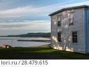Купить «Houses at waterfront, Margaree River, Margaree Harbour, Cabot Trail, Cape Breton Island, Nova Scotia, Canada», фото № 28479615, снято 11 июня 2016 г. (c) Ingram Publishing / Фотобанк Лори
